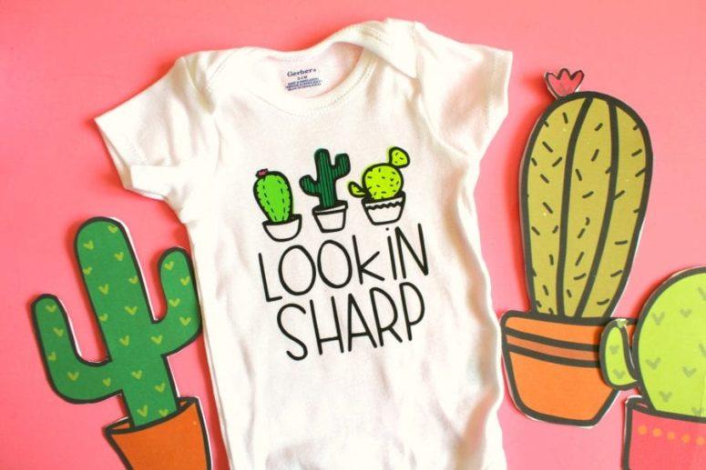DIY cactus Lookin Sharp baby onesie (via www.agirlandagluegun.com)