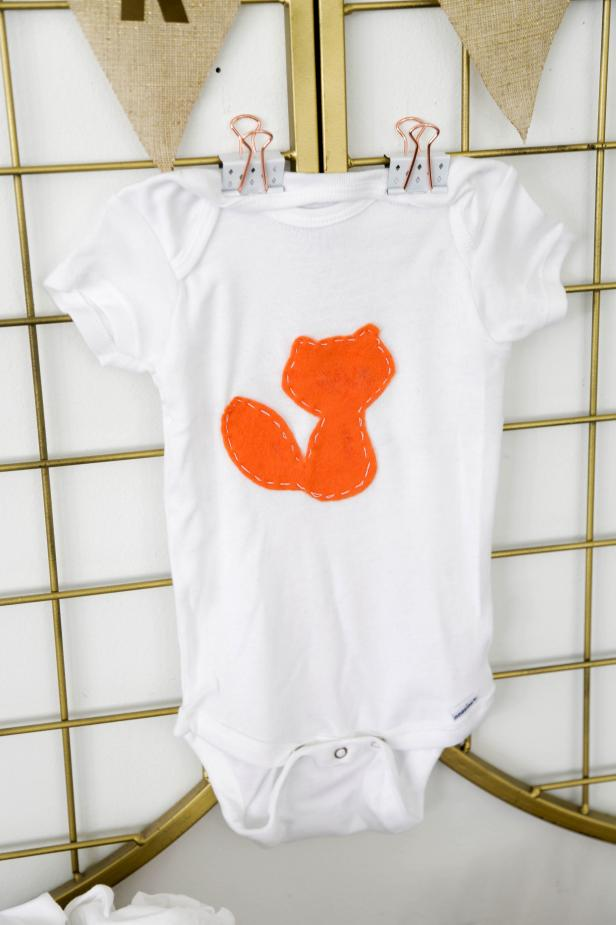 DIY felt applique baby onesies (via www.hgtv.com)