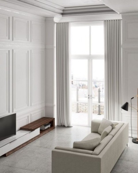 white wainscoting adds interest and chic to this all-white space and the minimalist style doesn't look boring at all