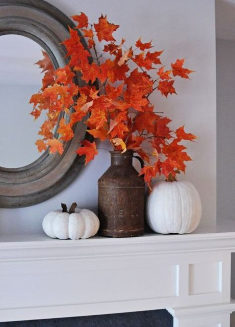 a beautiful bright fall leaf arrangement in a vintage metal jug is a cool and bright idea for your mantel