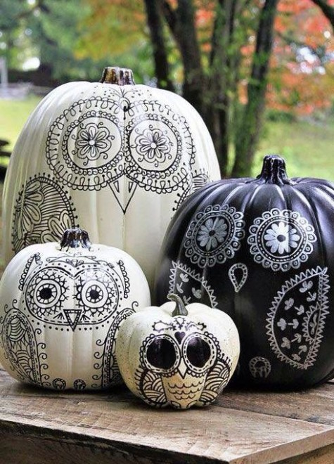 cool owl-inspired black and white pumpkins will add a whimsical and creative touch to your Halloween decor