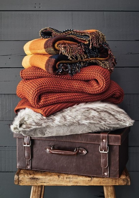 fall-colored knit, fabric and faux fur blankets to cuddle up and make yourself feel cozy at home