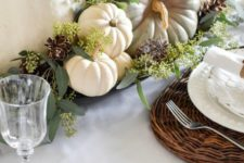 04 a beautiful and natural fall arrangement of heirloom pumpkins, pinecones, greenery and some foliage is a great centerpiece