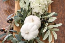 06 a cute natural fall centerpiece with foliage, white hydrangeas, foliage and olives for a harvest feel
