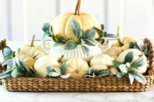 07 a cute neutral fall centerpiece of a woven tray, neutral pumpkins and pale foliage is easy to recreate
