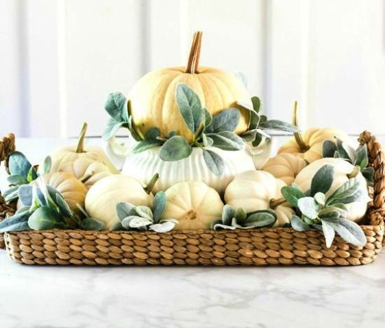 a cute neutral fall centerpiece of a woven tray, neutral pumpkins and pale foliage is easy to recreate