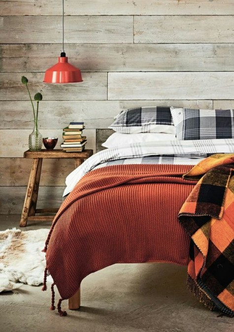 a rust pendant lamp and a knit blanket plus a rust and black checked one are easy pieces for a fall feel