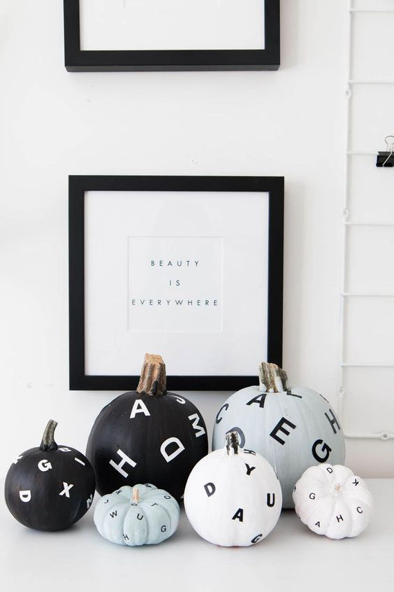 stylish monochromatic flying letter pumpkins are amazing for decorating your spaces for Hallowee with a modern feel