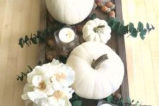 08 a dark stained wooden tray, white pumpkins, blooms, candles and acorns for a pretty fall centerpiece