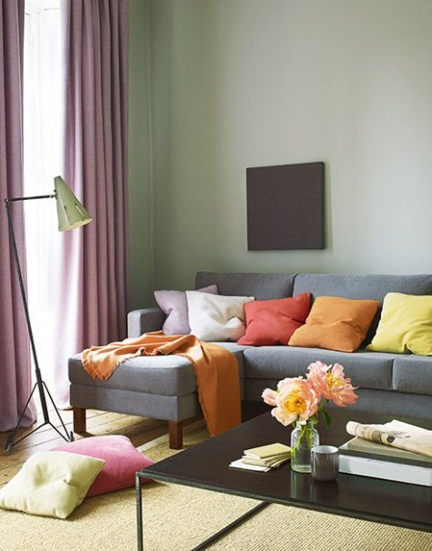 spruce up your living room with fall colored pillows, rugs and curtains to embrace the season