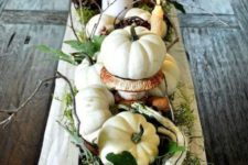 10 a gorgeous fall centerpiece using heirloom pumpkins, candles, driftwood, greenery, vine and foliage