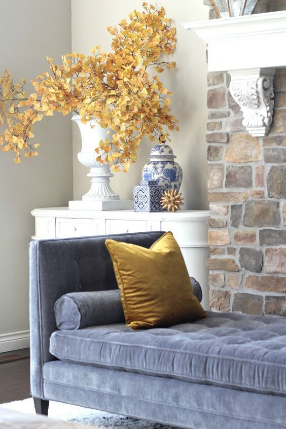 bright fall leaf branches in a large vintage urn are a creative and stylish idea for fall decor