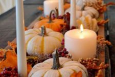 11 a pretty fall centerpiece of a wooden box, pumpkins, berries, bright foliage, moss, berries and candles