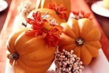 12 a rustic fall centerpiece of a white porcelain tray, berries, bright fall blooms and orange pumpkins