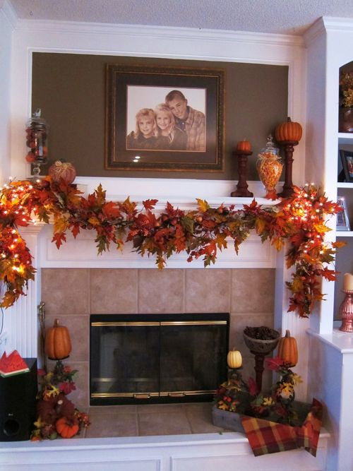 a bright fall leaf garland with lights over the mantel is a classic idea for stylish and simple fall decor