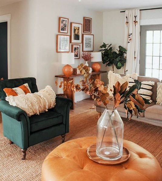 orange and rust decor touches bring a fall feel to the room and make it very welcoming