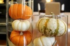 20 what can be more simple than placing some natural pumpkins in tall glass vases – this is a very modern idea