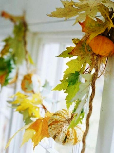 accent your window with a fall leaf garland with pumpkins and twine to make it fall-like