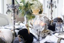 22 a monochromatic tablescape with black candles, black, white and grey fabric pumpkins, elegant porcelain and glasses with skeletons