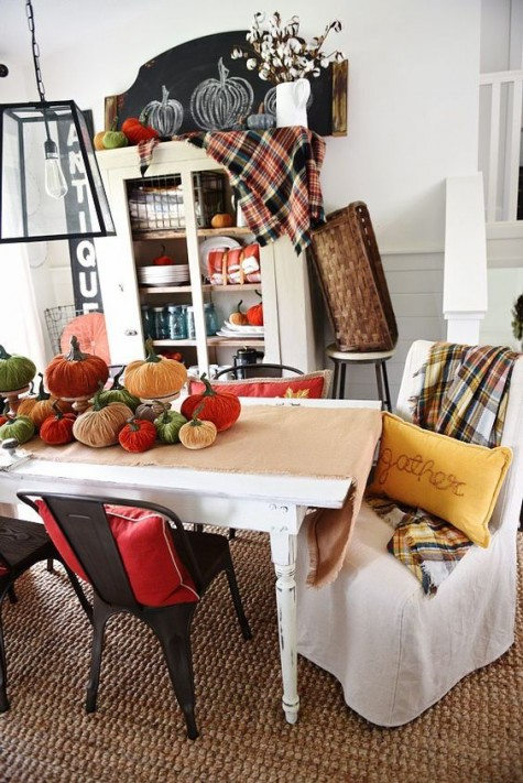 colorful velvet pumpkins and checked blankets take over this space and bring a fall feel