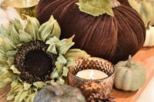 24 a simple rustic fall display with a wooden board, pinecones, faux pumpkins and blooms plus candles