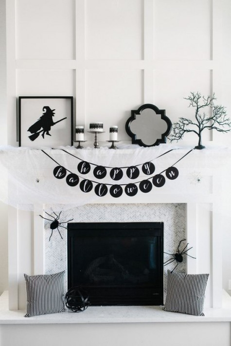 an ultra-modern and laconic black and white fireplace with signs, black and white pillows, spiders and banners