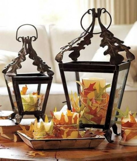 lanterns with candles wrapped with fall leaves and a tray will them will make up a cool fall leaf decoration or centerpiece