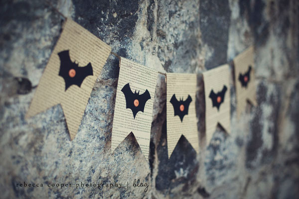 simple DIY Halloween bat bunting with newspaper and buttons