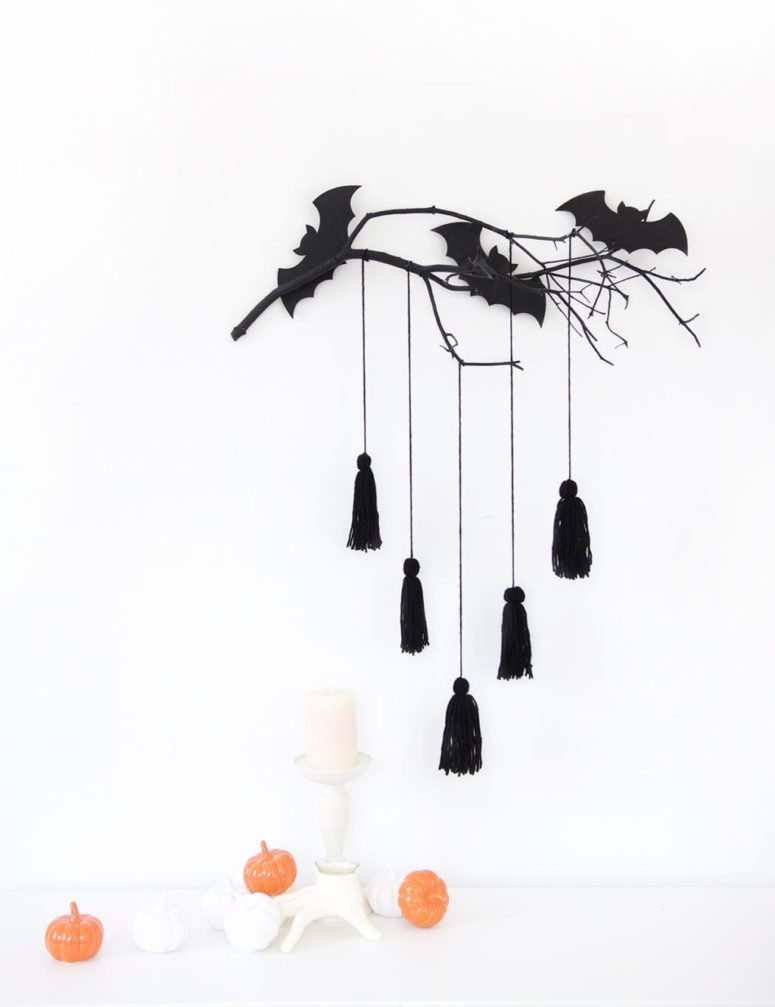 DIY modern Halloween decoration with branches and bats (via damasklove.com)