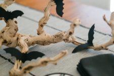 DIY Halloween centerpiece of a spooky branch and bats