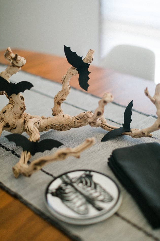 DIY Halloween centerpiece of a spooky branch and bats (via www.hunker.com)
