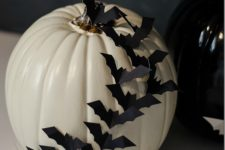 DIY white pumpkin with blakc bats across