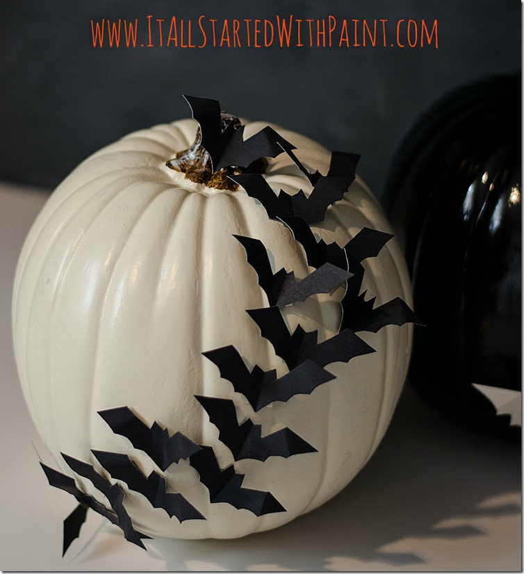 DIY white pumpkin with blakc bats across (via www.itallstartedwithpaint.com)
