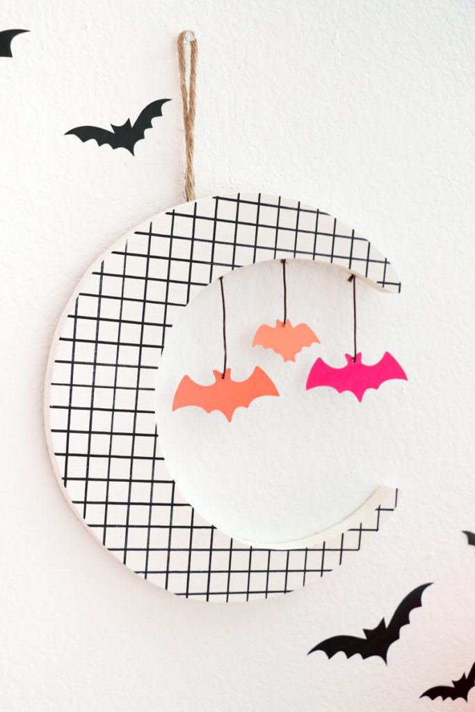 DIY 80s grid Halloween decoration with bats (via akailochiclife.com)
