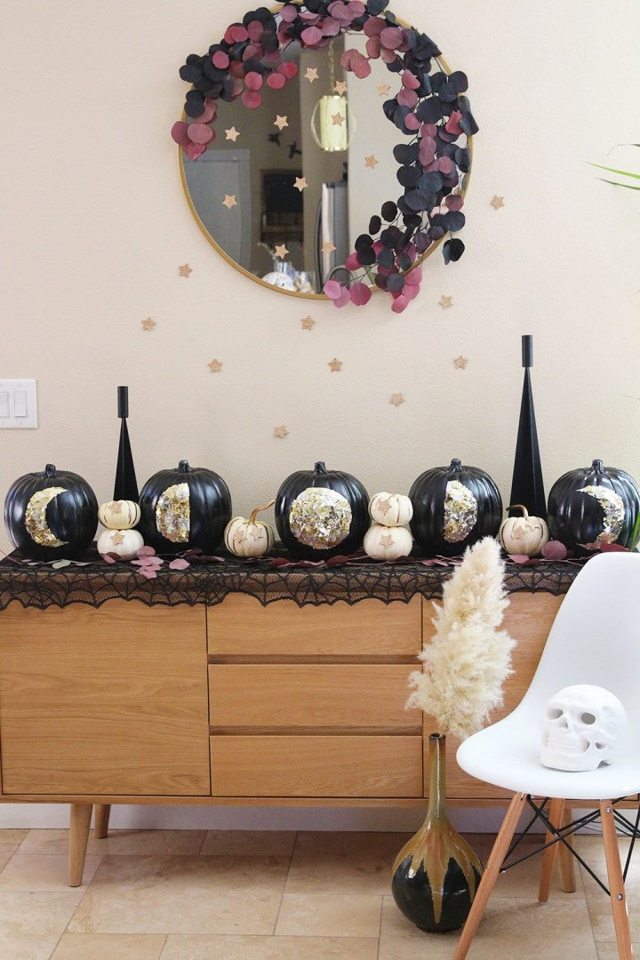 DIY black pumpkins with moon phases made of gold foil (via blissmakes.com)