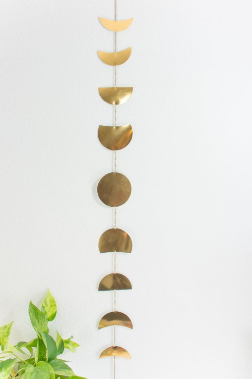 DIY gold metal moon phase wall hanging (via diyinpdx.com)