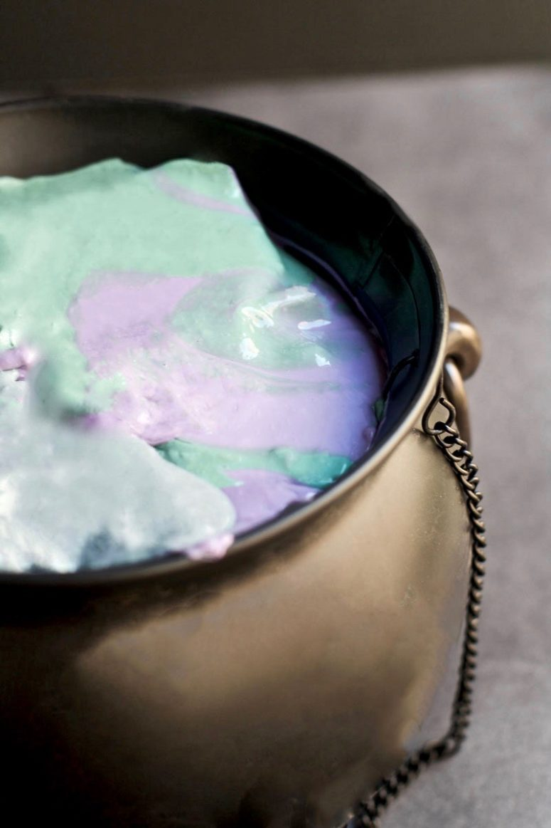 DIY purple and green witches' brew slime (via sincerelyjean.com)