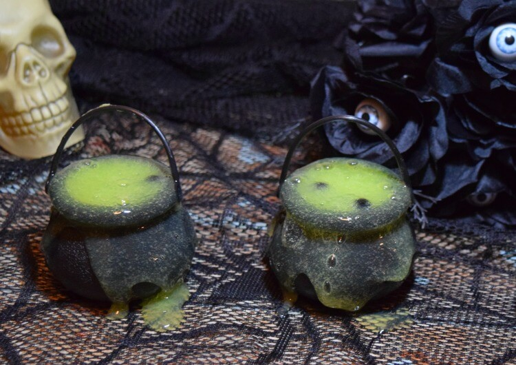 DIY neon yellow witches' brew slime with black water beads (via thetiptoefairy.com)