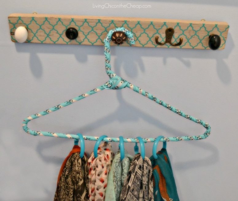 DIY scarf hanger using a clothes hanger and rings (via livingchiconthecheap.com)