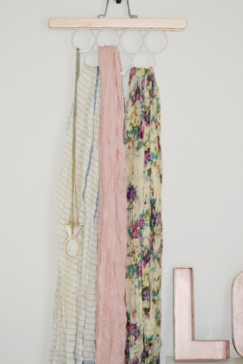 DIY scarf hanger using a pant hanger and shower curtain hooks (via www.shelterness.com)