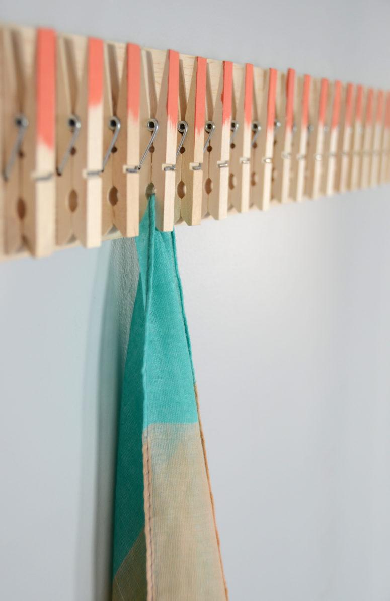 DIY clothespin scarf hanger  (via www.diys.com)