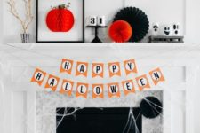 last minute Halloween mantel with paper fans, a 3D artwork, numbers, branches and spiderwebs
