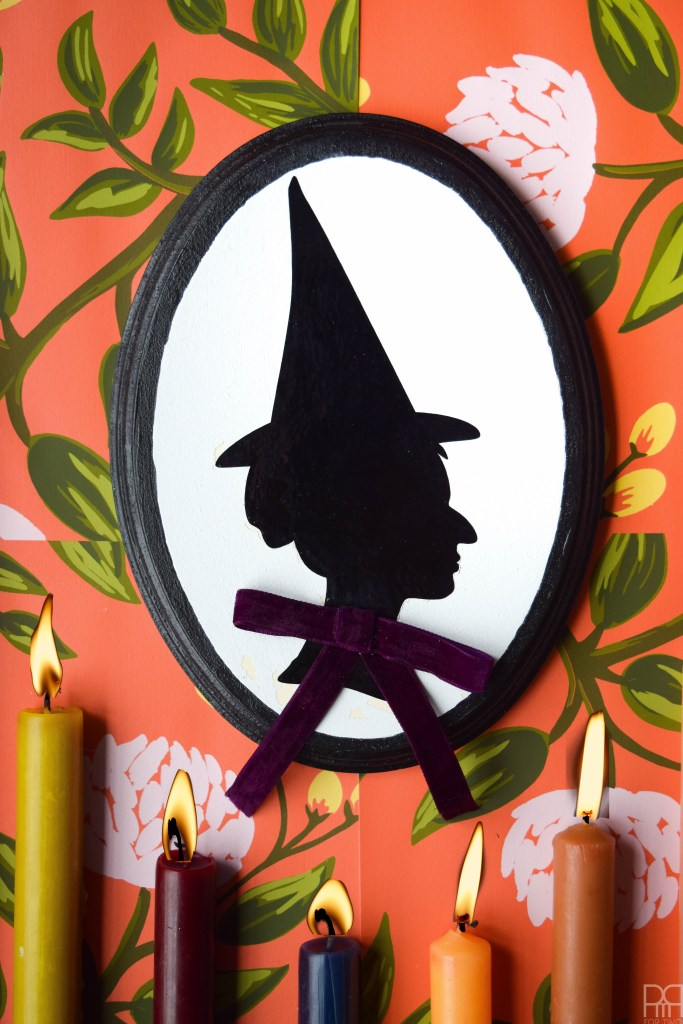 DIY witch silhouette decor with bright ribbons