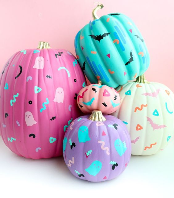colorful 80s inspired painted and stenciled pumpkins will make your Halloween decor fun adn whimsy