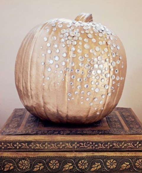 a copper pumpkin with rhinestones looks bold, glam and chic and will spruce up your decor with its bling