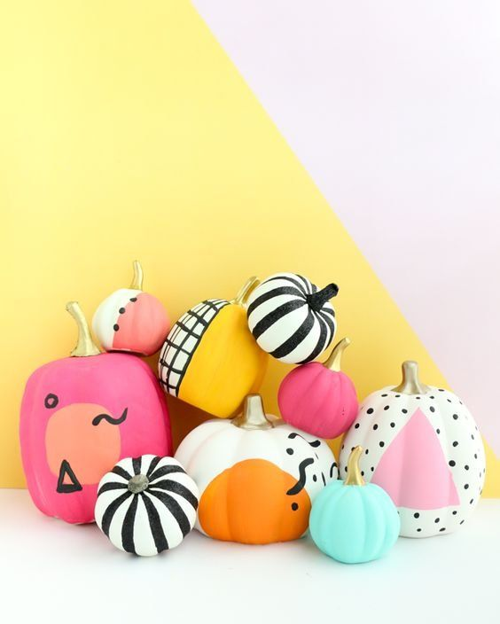 a batch of colorful and black and white painted pumpkins will fun up your party decor