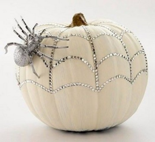 a white pumpkin with silver rhinestones and a silver spider is a glam and cool idea for Halloween
