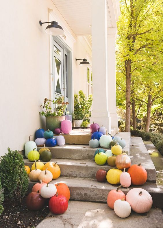 skip carved and scary pumpkins and choose bright and colorful ones to spruce up and brighten up the porch