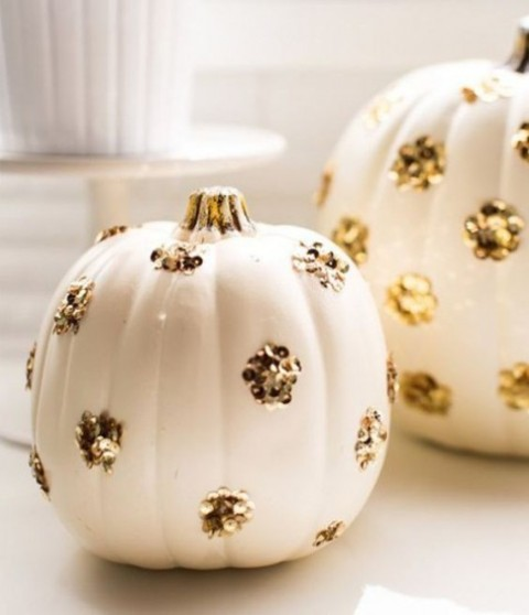 white pumpkins decorated with gold sequin polka dots are an easy and fast craft for Halloween decor