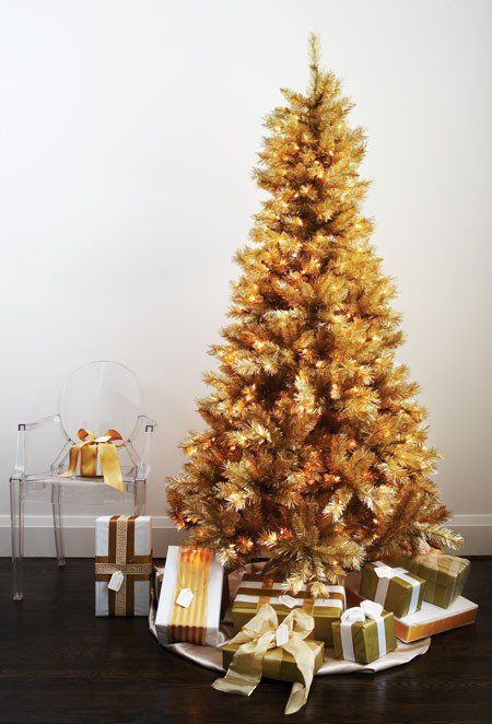 a gold pre-lit Christmas tree doesn't require any ornaments or decorations as it's bold itself